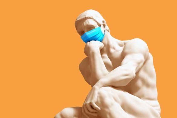 Der Denker mit Mundschutz beim analytischen Denken