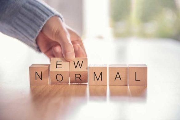 New Work und New Normal geschrieben auf Würfel.